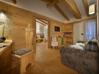 Kristiania Suite Cristallo - soggiorno con caminetto